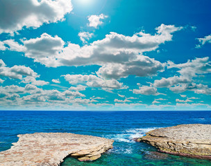 rocky coast and clouds