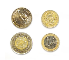 4 currencies one USA, Canadian, Euro, Pound coins