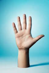 Hand showing all five fingers