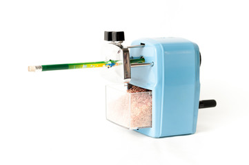 sharpener in side view with pencil on white background