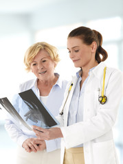 Female doctor talking with senior patient
