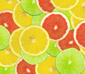 Abstract background of citrus slices. Closeup. Studio photograph