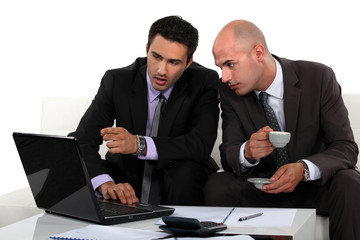 Business professionals discussing a report