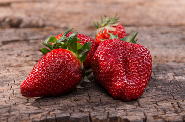 Strawberries over Wooden Background