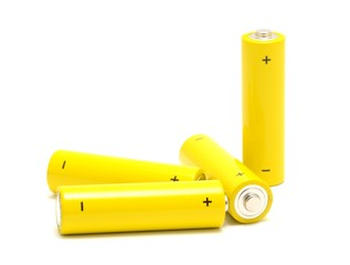 Yellow AA size batteries placed on a white background.