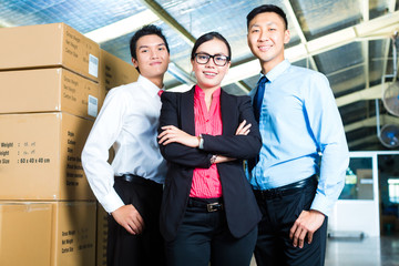 CEO and Businessmen in a warehouse