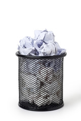 Wastepaper basket full of crumpled paper