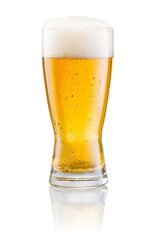 Glass of fresh beer with cap of foam isolated on white backgroun