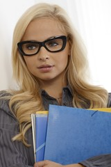 Pretty secretary with folders and glasses