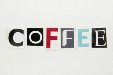 coffee word cut from newspaper on white handmade paper