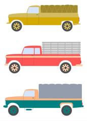 Stare ciężarówki z plandekami na białym tle.