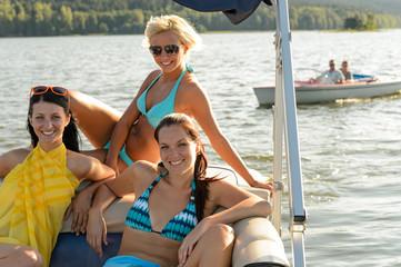 Young women sunbathing on boat