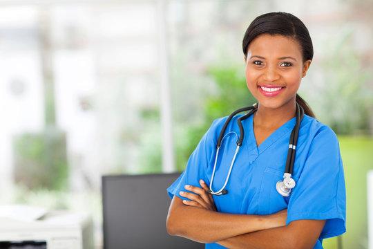 african american female pediatric nurse in office