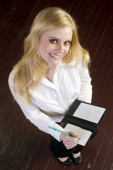 Young Attractive Female Server Writes and Order in the Restauran
