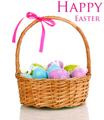Colorful easter eggs in basket isolated on white