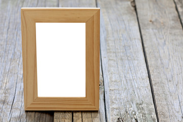 Old empty photo frame background concept on vintage planks