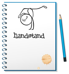 A notebook with a sketch of a person doing a handstand