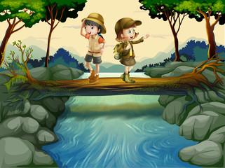 Foto op Plexiglas Rivier, meer Two kids crossing the river