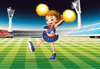 A cheerleader in the stadium