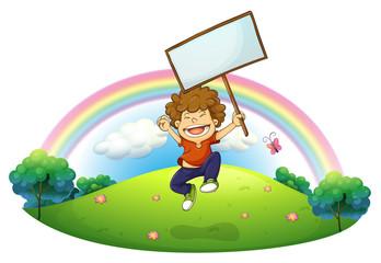 A little boy holding a signboard