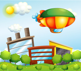 Canvas Prints Airplanes, balloon A tri-colored airship at the top of the buildings