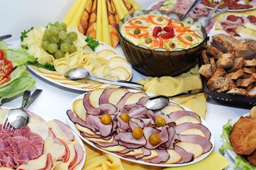 platters of ham, cheese, salad