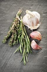 Herbs and garlic on gray slate