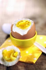 Hard boiled egg on yellow napkin