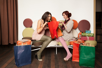 young girls on sofa with shopping bags
