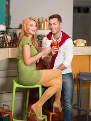 man and woman having drinks