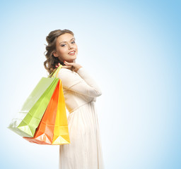 Beautiful young woman with the bright shopping bags