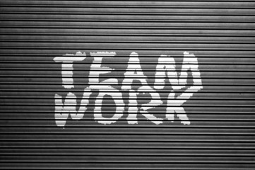 word Teamwork on metallic background