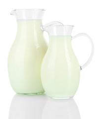 Pitchers of milk isolated on white