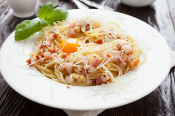 pasta with pieces of bacon and parmesan
