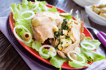 Tasty nutritious pie with eggs and spinach