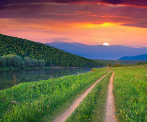 Wall Mural - Beautiful summer landscape on the mountain river. Sunrise