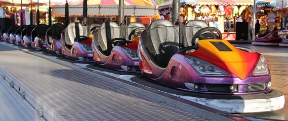 A Line of Dodgem Cars at a Fun Fair Amusement Park.