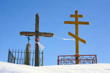 Crucifix and orthodox cross. Cross with flowers.
