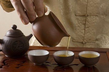 Master pouring tea during traditional Chinese tea ceremony
