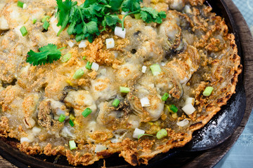 Crisp fried oyster pancake in hot plate