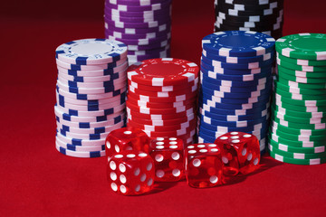 Stacks of Poker Chips with Playing Bones