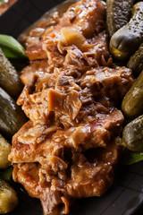 Pork loin with mushroom sauce. Dark light