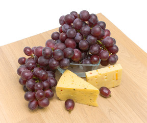 ripe grapes and cheese. Top view.