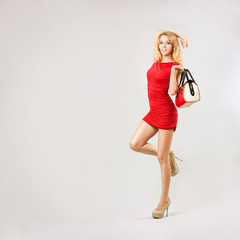 Beautiful Woman in Red Dress with Bag