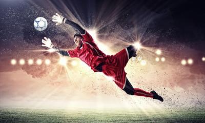 Foto auf AluDibond Fußball Goalkeeper catches the ball