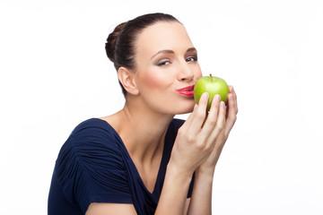 Girl kissing green apple