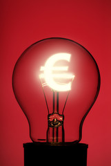 Light bulb with glowing Euro symbol on red