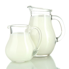 Two jugs of milk isolated on white