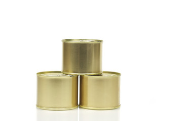 Three closed cans, isolated over white