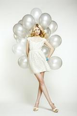 Fashion photo of beautiful woman with balloon. Girl posing